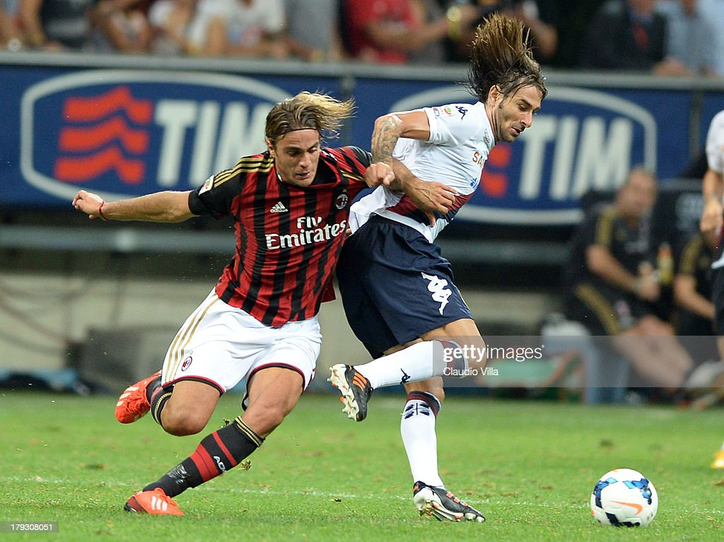 <a gi-track='captionPersonalityLinkClicked' href=/galleries/search?phrase=Alessandro+Matri&family=editorial&specificpeople=4501520 ng-click='$event.stopPropagation()'>Alessandro Matri</a> of AC Milan and Daniele Conti of Cagliari Calcio (R) compete for the ball during the Serie A match between AC Milan and Cagliari Calcio at San Siro Stadium on September 1, 2013 in Milan, Italy.