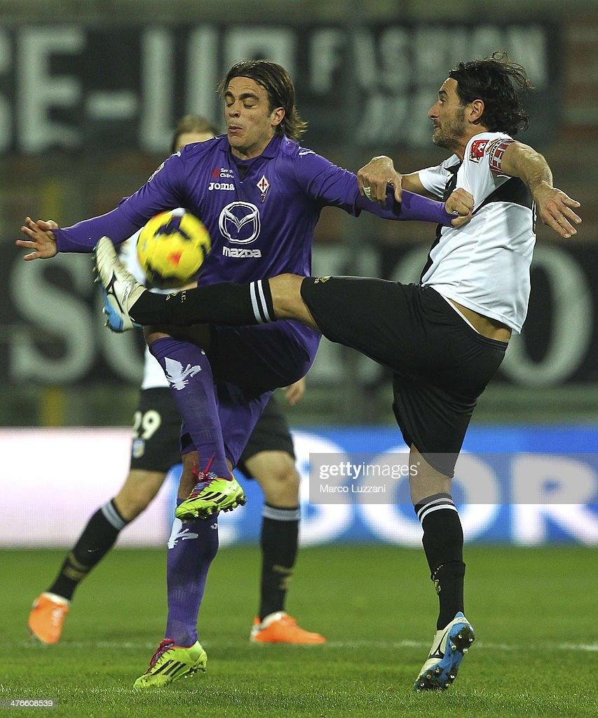 <a gi-track='captionPersonalityLinkClicked' href=/galleries/search?phrase=Alessandro+Matri&family=editorial&specificpeople=4501520 ng-click='$event.stopPropagation()'>Alessandro Matri</a> of ACF Fiorentina competes for the ball with Alessandro Lucarelli of Parma FC during the Serie A match between Parma FC and ACF Fiorentina at Stadio Ennio Tardini on February 24, 2014 in Parma, Italy.