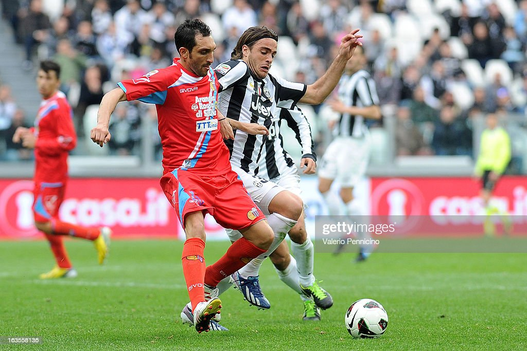 Alessandro Matri (R) of FC Juventus competes with Francesco Lodi of Calcio Catania during the Serie A match between FC Juventus and Calcio Catania at Juventus Arena on March 10, 2013 in Turin, Italy.