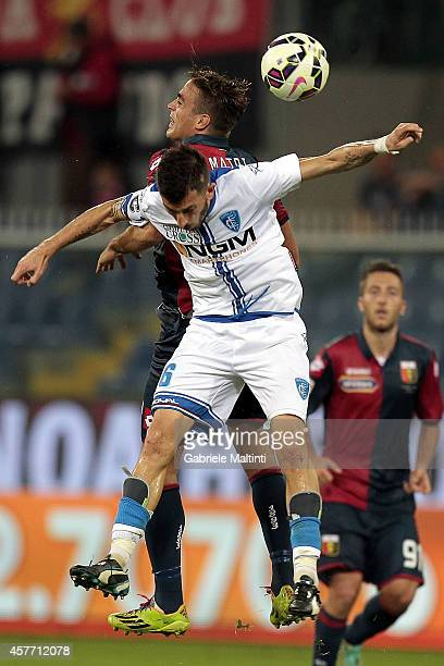 Alessandro Matri of Genoa CFC battles for the ball with Mirko Valdifiori of Empoli FC during the Serie A match between Genoa CFC and Empoli FC at...