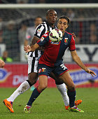 Alessandro Matri of Genoa CFC competes for the ball with Angelo Ogbonna of Juventus FC during the Serie A match between Genoa CFC and Juventus FC at...