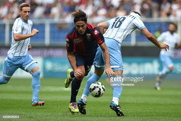 Alessandro Matri of Genoa CFC is challenged by Santiago Gentiletti of SS Lazio during the Serie A match between Genoa CFC and SS Lazio at Stadio...