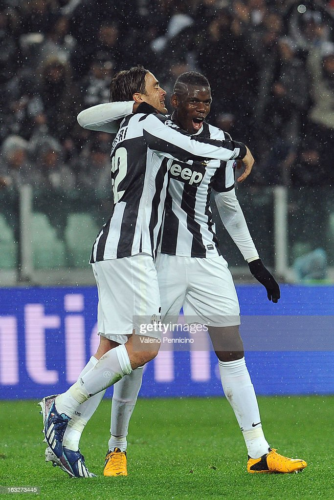 Alessandro Matri (L) of Juventus celebrates after scoring the opening goal with team mates Paul Pogba during the UEFA Champions League round of 16 second leg match between Juventus and Celtic at Juventus Arena on March 6, 2013 in Turin, Italy.