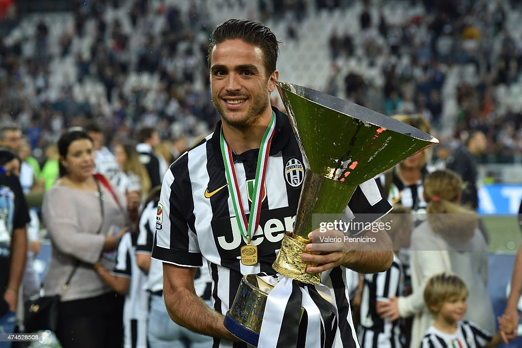 <a gi-track='captionPersonalityLinkClicked' href=/galleries/search?phrase=Alessandro+Matri&family=editorial&specificpeople=4501520 ng-click='$event.stopPropagation()'>Alessandro Matri</a> of Juventus FC celebrates with the Serie A Trophy at the end of the Serie A match between Juventus FC and SSC Napoli at Juventus Arena on May 23, 2015 in Turin, Italy.