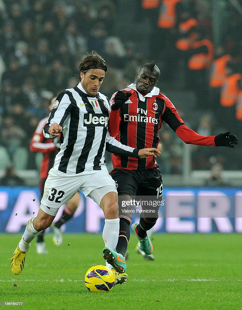 <a gi-track='captionPersonalityLinkClicked' href=/galleries/search?phrase=Alessandro+Matri&family=editorial&specificpeople=4501520 ng-click='$event.stopPropagation()'>Alessandro Matri</a> of Juventus FC is challenged by Mbaye Niang of AC Milan during the TIM cup match between Juventus FC and AC Milan at Juventus Arena on January 9, 2013 in Turin, Italy.