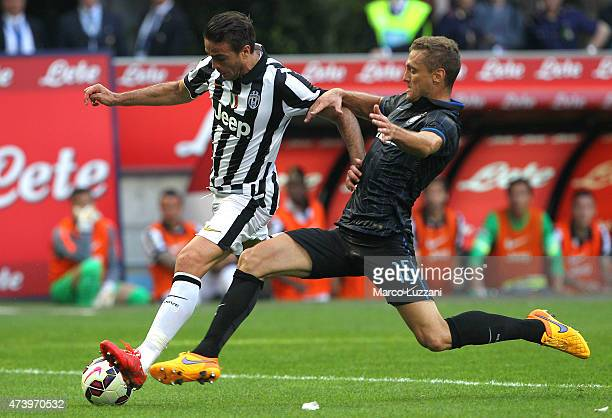 Alessandro Matri of Juventus FC is challenged by Nemanja Vidic of FC Internazionale Milano during the Serie A match between FC Internazionale Milano...
