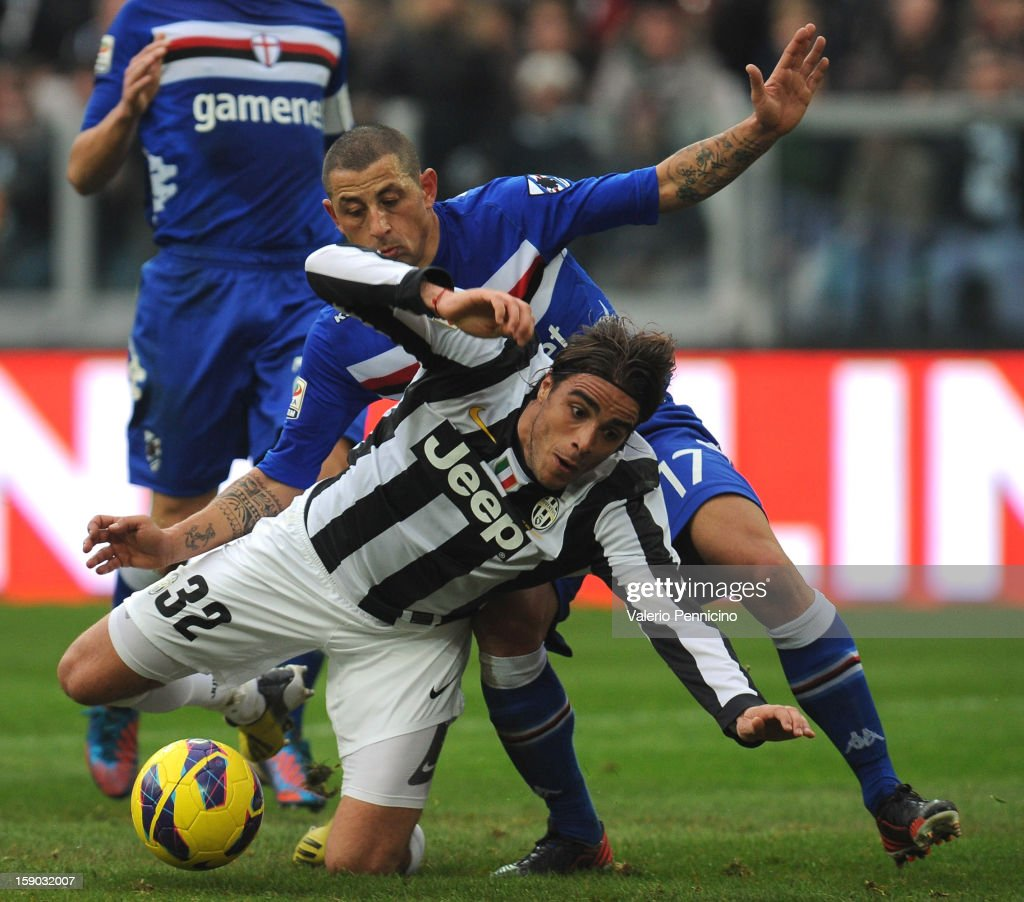 Alessandro Matri (L) of Juventus FC is tackled by Angelo Palombo of UC Sampdoria during the Serie A match between Juventus FC and UC Sampdoria at Juventus Arena on January 6, 2013 in Turin, Italy.