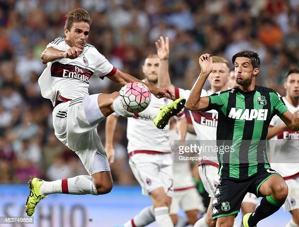 Alessandro Matri of Milan and Lorenzo Ariaudo of Sassuolo in action during the TIM preseason tournament match between AC Milan and US Sassuolo Calcio...