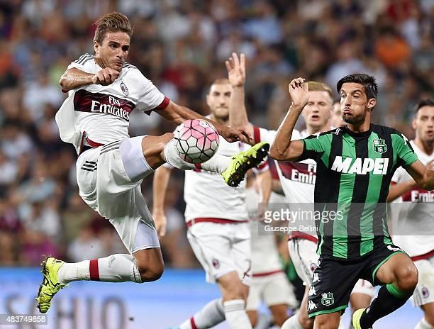 Alessandro Matri of Milan and Lorenzo Ariaudo of Sassuolo in action during the TIM preseason tournament match between AC Milan and US Sassuolo Calcio...
