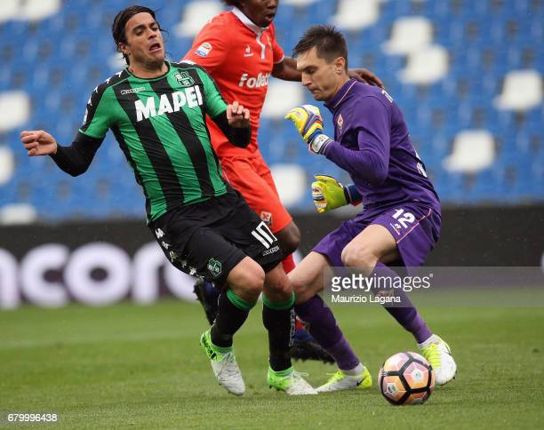 Alessandro Matri of Sassuolo competes for the ball with Ciprian Tatarusanu of Fiorentina during the Serie A match between US Sassuolo and ACF...