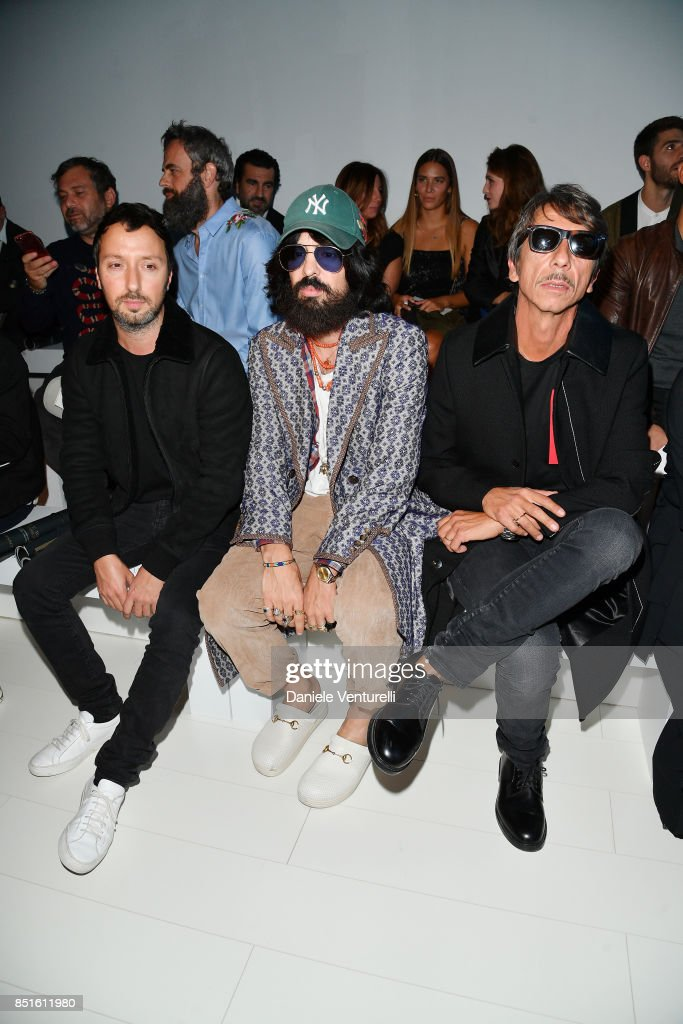 Alessandro Michele (C) and Pierpaolo Piccioli (R) attend the Versace show during Milan Fashion Week Spring/Summer 2018 on September 22, 2017 in Milan, Italy.