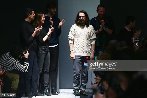 Alessandro Michele and the designers team walk the runway at the end of the Gucci Show as part of Milan Menswear Fashion Week Fall Winter 2015/2016...