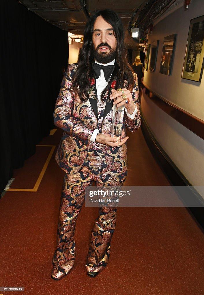 creator of gucci fashion. alessandro michele, winner of the international accessories designer for gucci, poses backstage at creator gucci fashion s