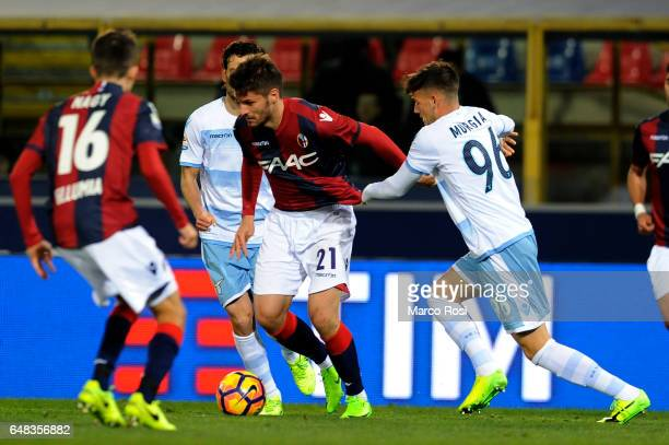 Alessandro Murgia of SS Lazio compete for the ball with Bruno Petkovic of Bologna FC during the Serie A match between Bologna FC and SS Lazio at...