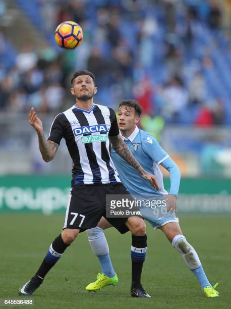 Alessandro Murgia of SS Lazio competes for the ball with Cyril Thereau of Udinese Calcio during the Serie A match between SS Lazio and Udinese Calcio...