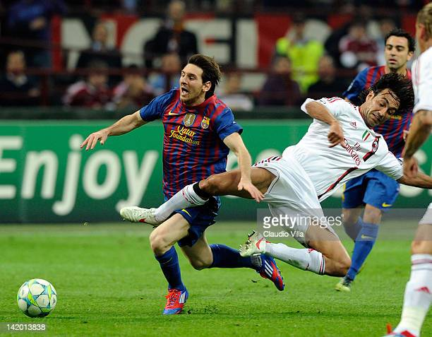 Alessandro Nesta of AC Milan and Lionel Messi of Barcelona compete for the ball during the UEFA Champions League quarter final first leg match...