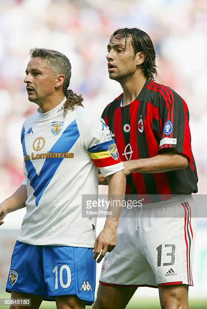 Alessandro Nesta of AC Milan marks Roberto Baggio of Brescia during the Serie A match between AC Milan and Brescia on May 16 2004 in Milan Italy