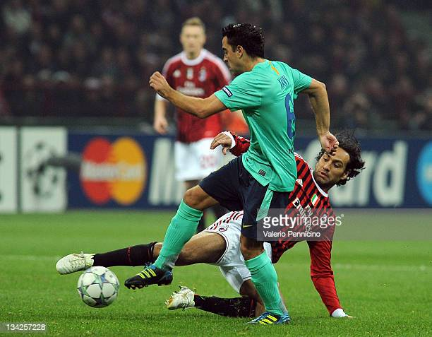 Alessandro Nesta of AC Milan tackles Xavi Hernandez of FC Barcelona during the UEFA Champions League group H match between AC Milan and FC Barcelona...