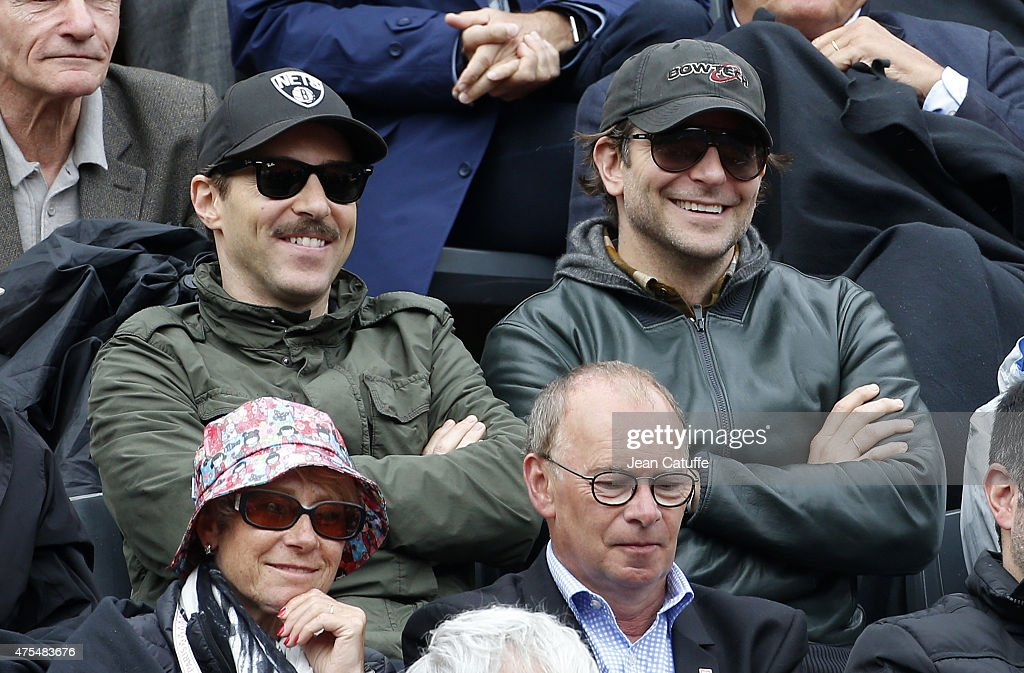 Alessandro Nivola and Bradley Cooper attend day 8 of the French Open 2015 at Roland Garros stadium on May 31, 2015 in Paris, France.
