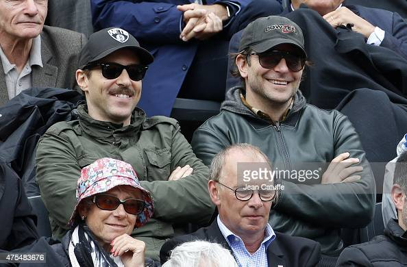 Alessandro Nivola and Bradley Cooper attend day 8 of the French Open 2015 at Roland Garros stadium on May 31 2015 in Paris France