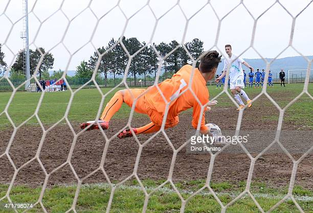 Alessandro Plizzari goalkeeper of Italy U15 saves a penalty from Bozic Domen of Slovenia U15 during the 4 Nations Tournament Third Place Playoff...