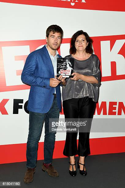 Alessandro Roja and guest pose with the award during the Ciak For Women 2016 on October 16 2016 in Rome Italy
