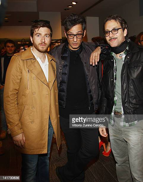 Alessandro Roja Rosario Fiorello Beppe Fiorello attend the 'Diesel Together With Ducati' cocktail party on March 22 2012 in Rome Italy