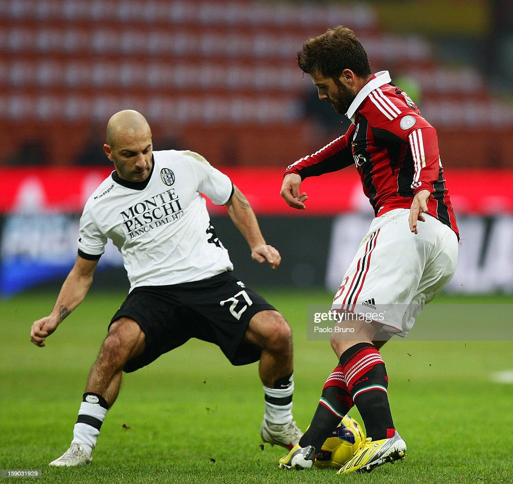 Alessandro Rosina (L) of AC Siena competes for the ball with Antonio Nocerino of AC Milan during the Serie A match between AC Milan and AC Siena at San Siro Stadium on January 6, 2013 in Milan, Italy.