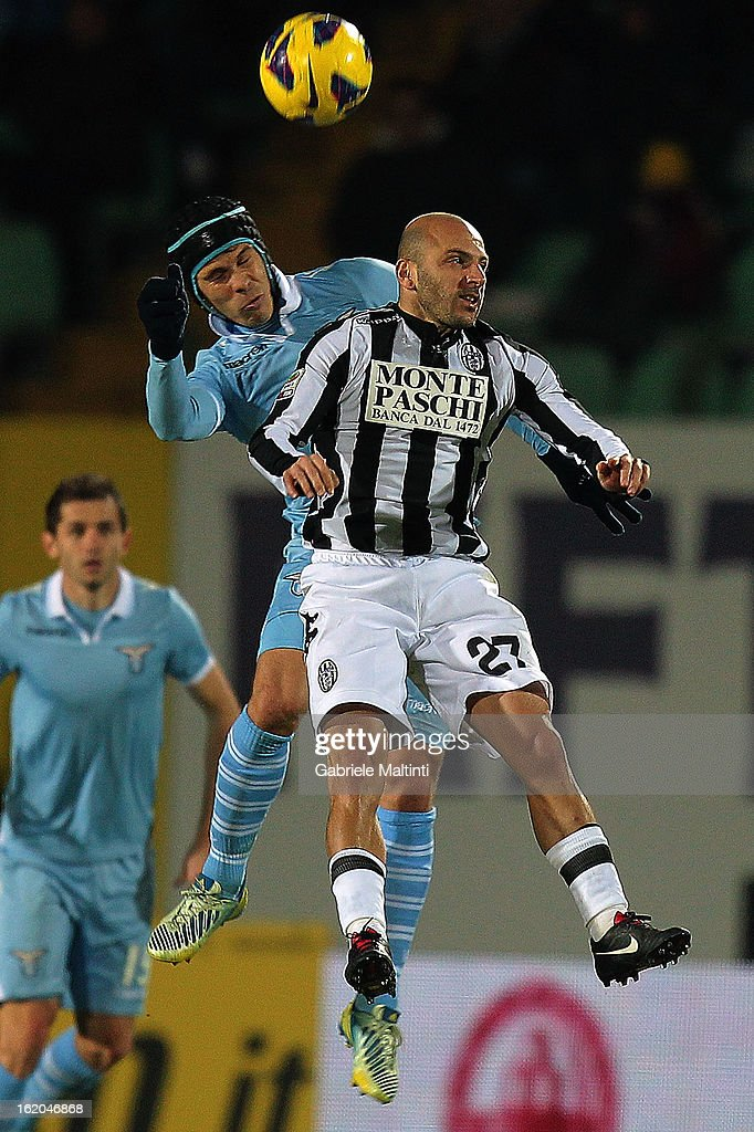 Alessandro Rosina of AC Siena fights for a high ball with <a gi-track='captionPersonalityLinkClicked' href=/galleries/search?phrase=Hernanes&family=editorial&specificpeople=4522139 ng-click='$event.stopPropagation()'>Hernanes</a> of SS Lazio during the Serie A match between AC Siena and S.S. Lazio at Stadio Artemio Franchi on February 18, 2013 in Siena, Italy.