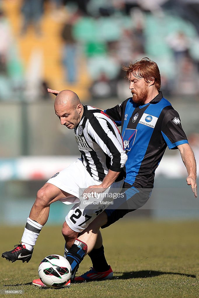 Alessandro Rosina of AC Siena fights for the ball with Davide Biondini of Atalanta BC during the Serie A match between AC Siena and Atalanta BC at Stadio Artemio Franchi on March 3, 2013 in Siena, Italy.