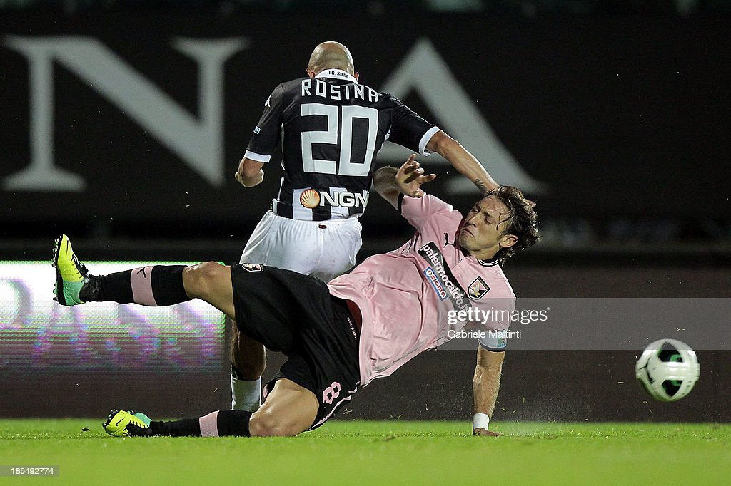 Alessandro Rosina of AC Siena fights for the ball with Edgar Osvaldo Barreto of US Citta' di Palermo during the Serie B match between AC Siena and US Citta di Palermo at Artemio Franchi - Mps Arena on October 21, 2013 in Siena, Italy.