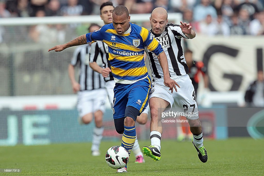 Alessandro Rosina of AC Siena fights for the ball with Jonathan Ludovic Biabiany of Parma FC during the Serie A match between AC Siena and Parma FC at Stadio Artemio Franchi on April 7, 2013 in Siena, Italy.