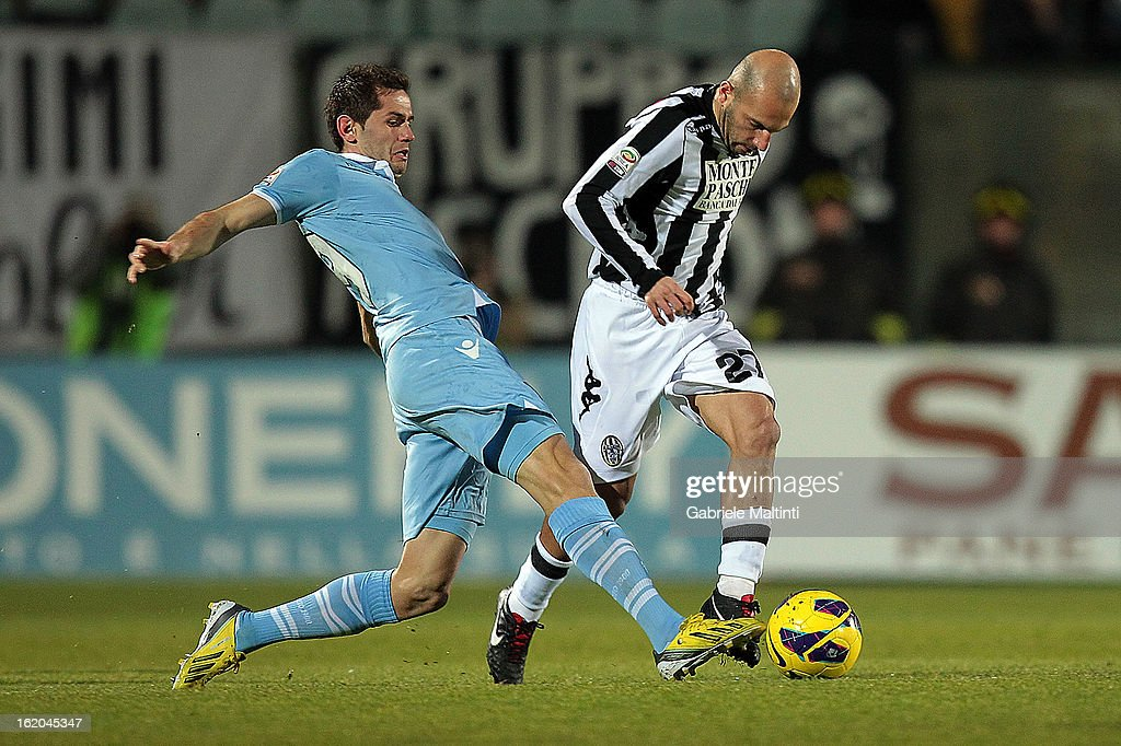 Alessandro Rosina of AC Siena fights for the ball with Senad Lulic of SS Lazio during the Serie A match between AC Siena and S.S. Lazio at Stadio Artemio Franchi on February 18, 2013 in Siena, Italy.