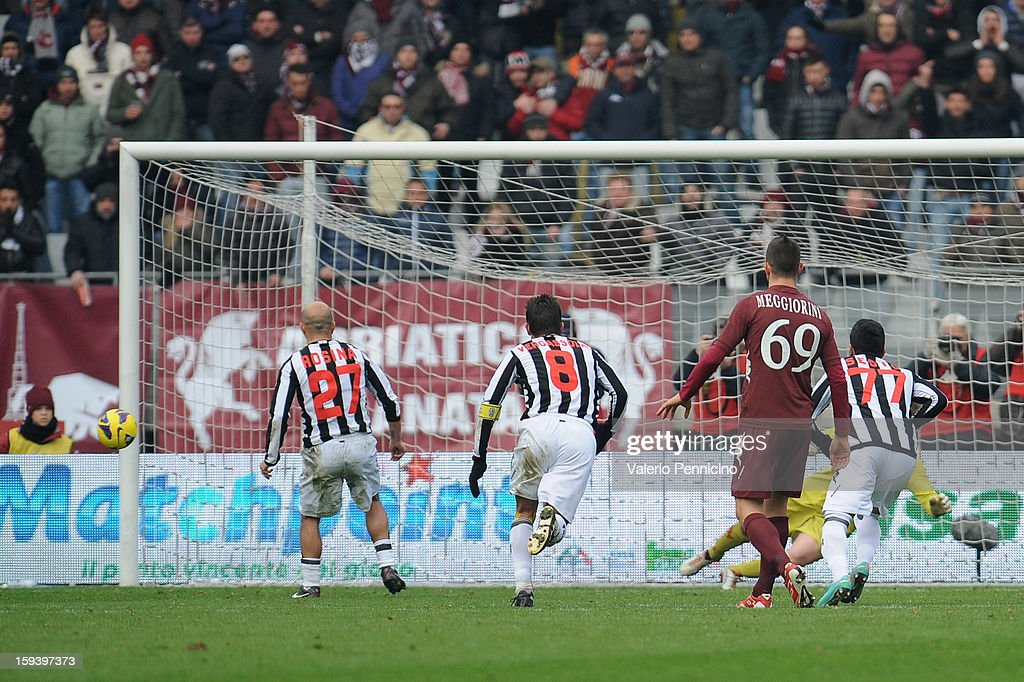 Alessandro Rosina (L) of AC Siena misses a penalty-kick during the Serie A match between Torino FC and AC Siena at Stadio Olimpico di Torino on January 13, 2013 in Turin, Italy.