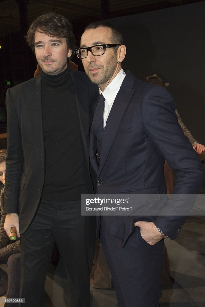 Alessandro Sartori, Berluti's artistic director (R) and <a gi-track='captionPersonalityLinkClicked' href=/galleries/search?phrase=Antoine+Arnault&family=editorial&specificpeople=676045 ng-click='$event.stopPropagation()'>Antoine Arnault</a>, Berluti's chief executive, attend the Berluti Men Autumn / Winter 2013 presentation at the Great Gallery of Evolution in the National Museum of Natural History, as part of Paris Fashion Week on January 18, 2013 in Paris, France.