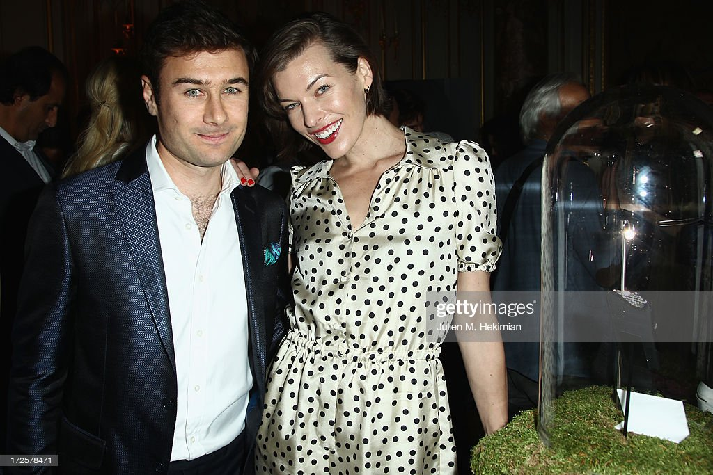 Alessandro Savelli and <a gi-track='captionPersonalityLinkClicked' href=/galleries/search?phrase=Milla+Jovovich&family=editorial&specificpeople=202207 ng-click='$event.stopPropagation()'>Milla Jovovich</a> attend the Founder And CEO Alessandro Savelli And Contemporary Style Icon Julia Restoin Roitfeld Launch SAVELLI The World's First Luxury Smart Phone Especially For Women During Haute Couture Week at Musee Jacquemart-Andre on July 3, 2013 in Paris, France.