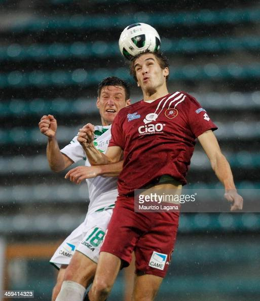 Alessandro Sbaffo of Reggina competes for the ball in air with Eros Schiavon of Avellino during the Serie B match between Reggina Calcio and US...