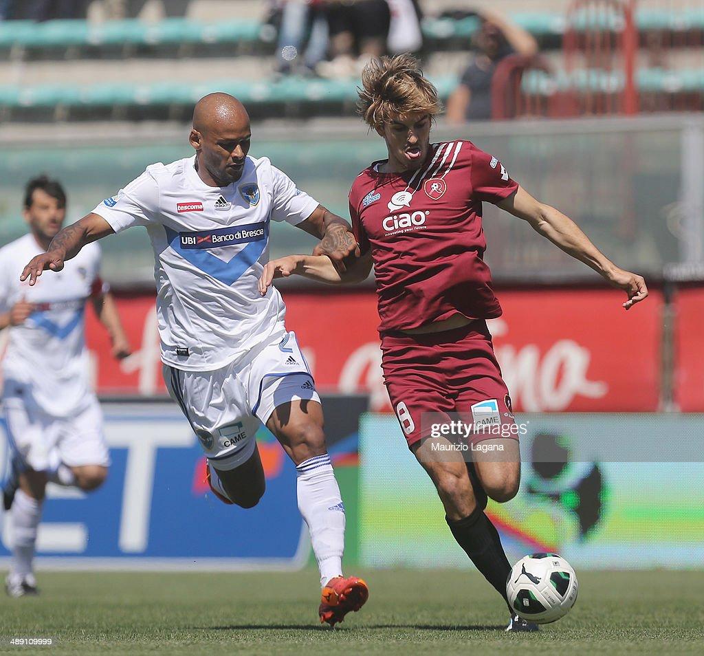Alessandro Sbaffo (R) of Reggina competes for the ball with Ruben Oliveira of Brescia during the Serie A match between Reggina Calcio and Brescia Calcio on May 10, 2014 in Reggio Calabria, Italy.