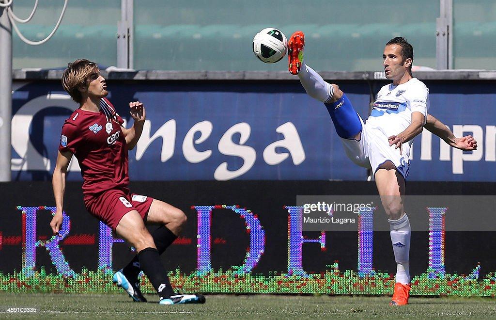 Alessandro Sbaffo (L) of Reggina competes for the ball with Valerio Di Cesare of Brescia during the Serie B match between Reggina Calcio and Brescia Calcio on May 10, 2014 in Reggio Calabria, Italy.