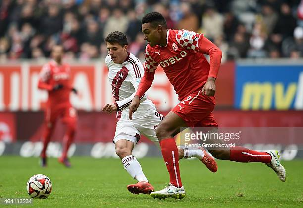 Alessandro Schoepf of 1 FC Nuernberg and Jonathan Tah of Fortuna Duesseldorf chase the ball during the Second Bundesliga match between Fortuna...