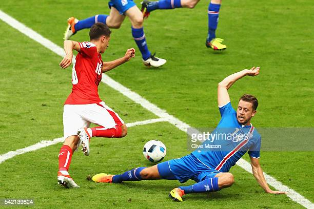 Alessandro Schoepf of Austria goes passed Kari Arnason of Iceland on his way to score his team's first goal during the UEFA EURO 2016 Group F match...