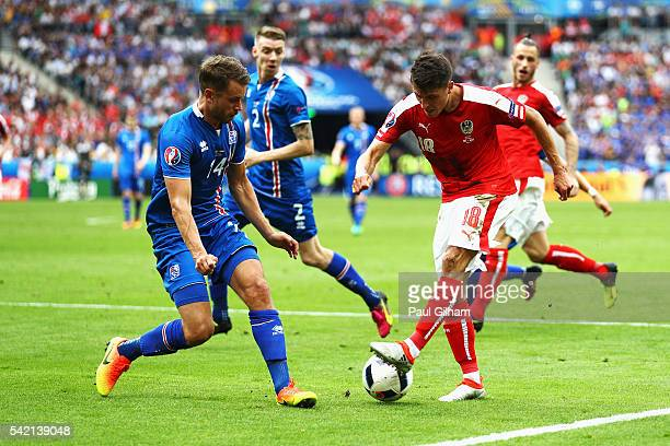 Alessandro Schoepf of Austria takes on Kari Arnason of Iceland during the UEFA EURO 2016 Group F match between Iceland and Austria at Stade de France...