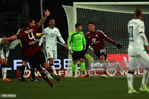 Alessandro Schoepf of Nuernberg celebrates his team's first goal with team mate Dave Bulthuis during the Second Bundesliga match between 1 FC...