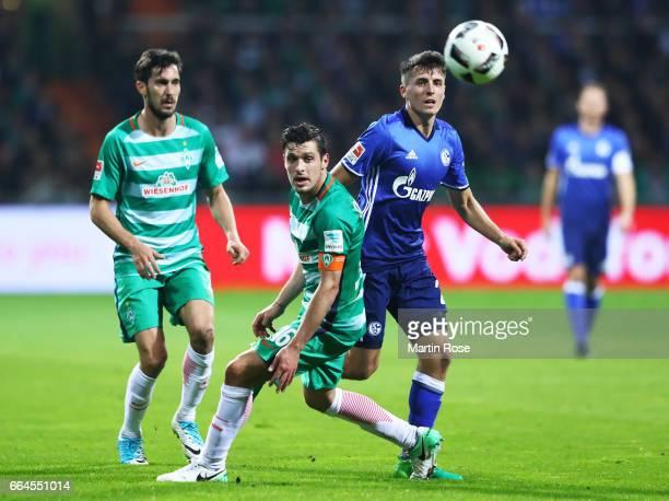 Alessandro Schoepf of Schalke 04 challenges Zlatko Junuzovic of Werder Bremen during the Bundesliga match between Werder Bremen and FC Schalke 04 at...
