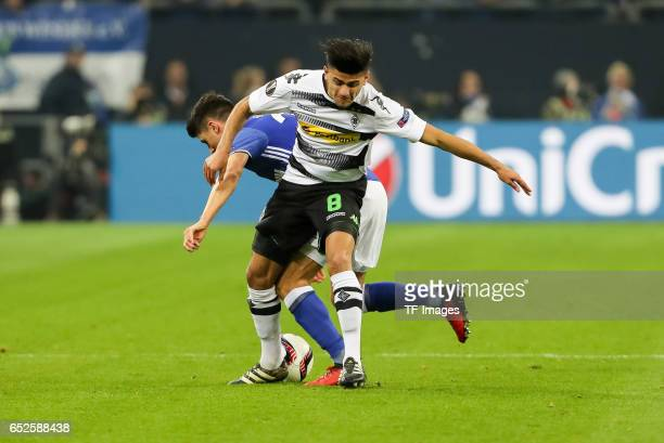 Alessandro Schoepf of Schalke and Mahmoud Dahoud of Borussia Moenchengladbach battle for the ball during the UEFA Europa League Round of 16 first leg...