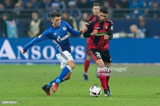 Alessandro Schoepf of Schalke and Vincenzo Grifo of Freiburg battle for the ball during the Bundesliga match between FC Schalke 04 and SC Freiburg at...