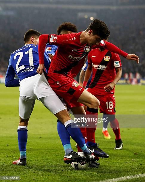 Alessandro Schoepf of Schalke battles for the ball with Kai Havertz of Leverkusen during the Bundesliga match between FC Schalke 04 and Bayer 04...