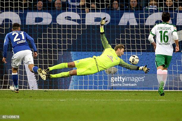 Alessandro Schoepf of Schalke scores the opening goal by a header against goalkeeper Felix Wiedwald of Bremen during the Bundesliga match between FC...