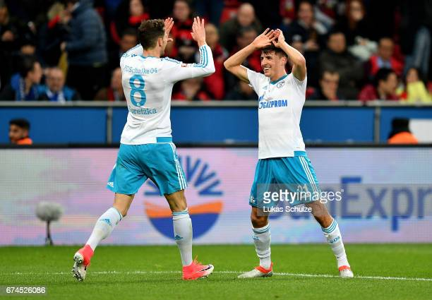 Alessandro Schoepf of Schalkee celebrate with team mate Leon Goretzka after he scores the 3rd goal during the Bundesliga match between Bayer 04...