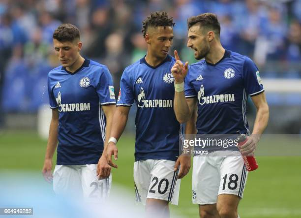 Alessandro Schoepf Thilo Kehrer and Daniel Caligiuri of Schalke looks on during the Bundesliga match between FC Schalke 04 and Borussia Dortmund at...